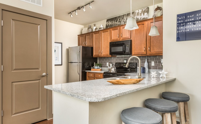 Kitchen with peninsula, stool seating and pendant lighting.